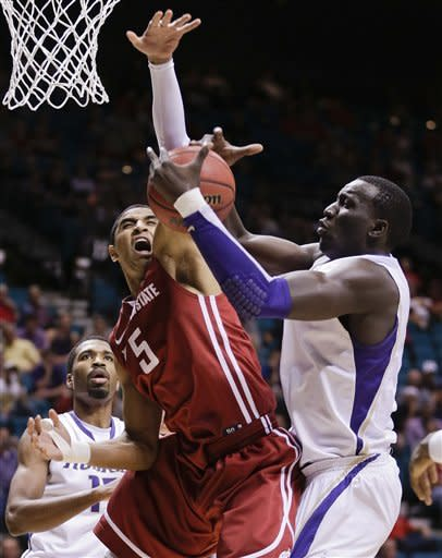 Washington holds off rival WSU 64-62 at Pac-12