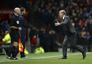 Manchester United manager Moyes runs onto the pitch as he appeals for a penalty for his player Ashley Young during their English Premier League soccer match against Tottenham Hotspur in Manchester