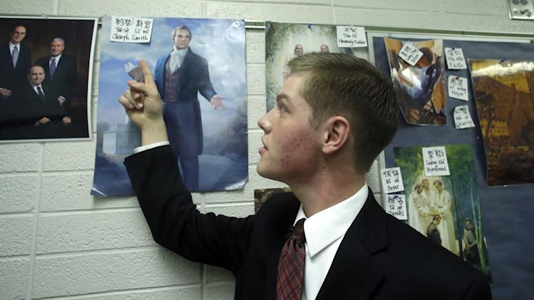 In this Jan. 8, 2013 photo, 18-year-old Mormon missionary Jorgen Sumsion, from Kaysville, Utah, points to the spelling of Joseph Smith in Mandarin Chinese at the Missionary Training Center in Provo, Utah. The Mormon churchís recent decision to lower the minimum age for missionaries has been greeted with† enthusiasm from many young members of the LDS church -- but especially young women. About half of all new applications to go on missions since the announcement have been from women, the church says. Prior to that, only 15 percent of missionaries were women. (AP Photo/Rick Bowmer)