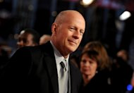 In this picture made available Tuesday Feb. 5, 2013, US actor Bruce Willis , arrives for the premiere of the movie &#39;A Good Day to Die Hard&#39; in Berlin, Germany, Monday Feb. 4, 2013. (AP Photo/dpa, Britta Pedersen)