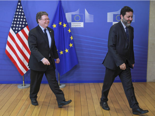 EU chief negotiator Ignacio Garcia Bercero, right, ushers U.S. chief negotiator Dan Mullaney, ahead of the start of the fourth round of the Transatlantic Trade and Investment Partnership (TTIP), at th