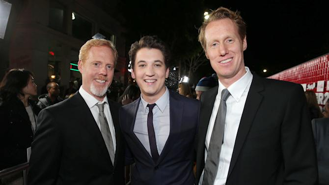 """Director/Writer Scott Moore, Miles Teller and Director/Writer Jon Lucas arrive at the LA premiere of """"21 and Over"""" at the Westwood Village Theatre on Thursday, Feb. 21, 2013 in Los Angeles. (Photo by Eric Charbonneau/Invision/AP)"""