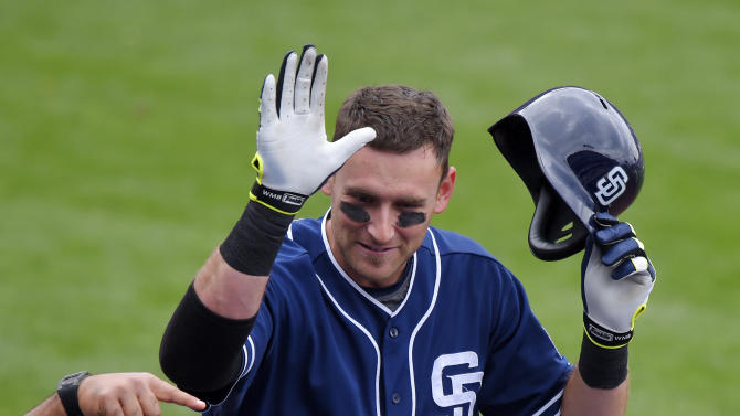 San Diego Padres' Will Middlebrooks, top, is congratulated by teammate Justin Upton after hitting a solo home run during the third inning of a baseball game against the Los Angeles Dodgers, Sunday, May 24, 2015, in Los Angeles. (AP Photo/Mark J. Terrill)