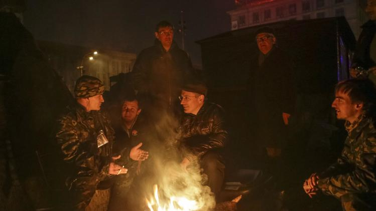 Russian former oil tycoon Mikhail Khodorkovsky speaks with members of the Maidan self-defense battalion during his visit to Kiev