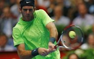 Argentina&#39;s Juam Martin Del Potro returns the ball to Australia&#39;s Marinko Matosevic during their quarter final match as part of the Vienna ATP 250 tennis tournament. Del Portro won 6-2, 6-2