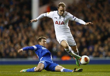 Tottenham Hotspur's Eriksen is challenged by Dnipro's Rotan during their Europa League soccer match at White Hart Lane