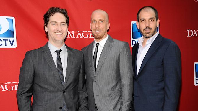 "FILE - This June 28, 2012 file photo shows creators and executive producers Daniel Zelman, left, Todd Kessler and Glenn Kessler, right, attending the ""Damages"" season five premiere at the Paris Theater in New York. ""Damages,"" starring Glenn Close and Rose Byrne, returns Wednesday at 9 p.m. EDT on DirecTV. (Photo by Evan Agostini/Invision/AP, file)"