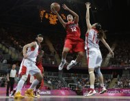 USA's Diana Taurasi (12) drives past China defender Ma Zengyu (11) during a preliminary women's basketball game at the 2012 Summer Olympics, Sunday, Aug. 5, 2012, in London. (AP Photo/Eric Gay)