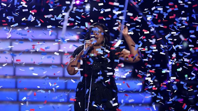 """Candice Glover performs on stage after she was announced the winner at the """"American Idol"""" finale at the Nokia Theatre at L.A. Live on Thursday, May 16, 2013, in Los Angeles. (Photo by Matt Sayles/Invision/AP)"""