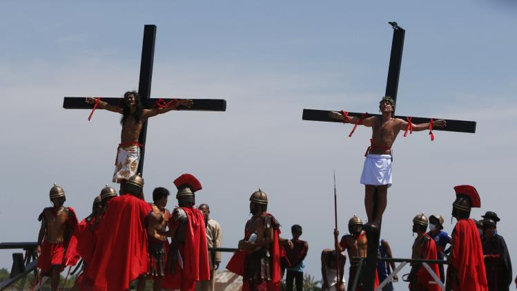Danish film maker Olsen and a Filipino penitent are crucified on wooden crosses during a Good Friday ritual of the reenactment of the death of Jesus Christ in San Fernando