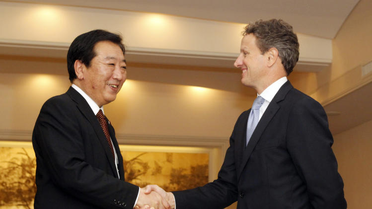 CORRECTS FIRST NAME OF NODA - Japan's Prime Minister Yoshihiko Noda, left, and U.S. Treasury Secretary Timothy Geithner shake hands as they meet on the sidelines of the annual meetings of the IMF and the World Bank Group in Tokyo, Friday, Oct. 12, 2012. (AP Photo/Yuriko Nakao, Pool)