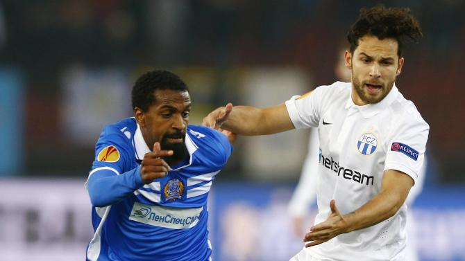 FC Zurich's Chiumiento challenges Hamdani of Apollon Limassol during their Europa League Group A soccer match in Zurich