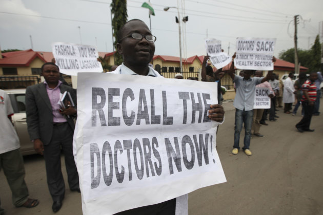 Olusola Adeyelu one of the sacked doctors joins a protest against the sacking of doctors during a hearing at the Industrial court in Lagos, Nigeria, Wednesday, May, 16. 2012. The mass firing of doctors in Nigeria's largest city is exposing the downfalls of the nation's failing medical system. Lagos state, which is home to the megacity of Lagos, recently fired 788 doctors who had been on strike and protesting their wages. OnWednesday, lawyers for the doctors and the government appeared in an industrial court to argue about the case. (AP Photo/Sunday Alamba)