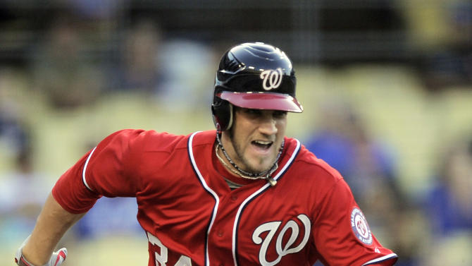 Washington Nationals' Bryce Harper runs to first during the second inning of their baseball game against the Los Angeles Dodgers, Saturday, April 28, 2012, in Los Angeles. Harper was thrown out at first. (AP Photo/Mark J. Terrill)