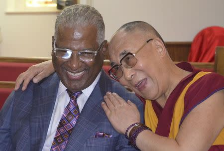 The Dalai Lama, spiritual leader of Tibet, talks with Birmingham mayor William Bell during an interview at the 16th Street Baptist Church in Birmingham