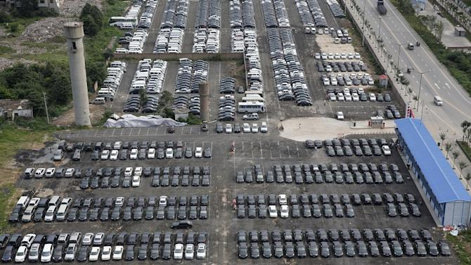 Impounded government vehicles are seen at a parking lot before being auctioned in Xi'an