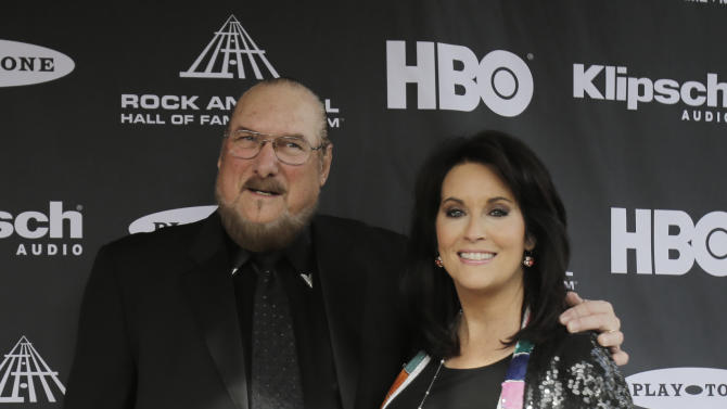 Steve Cropper, left, arrives at the Rock and Roll Hall of Fame Induction Ceremony Saturday, April 18, 2015, in Cleveland. (AP Photo/Tony Dejak)