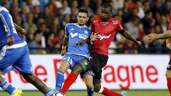 Olympique Marseille's Cabella challenges Guingamp's Diallo during their French Ligue 1 soccer match at the Roudourou stadium in Guingamp
