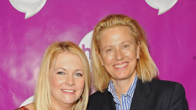Melissa Joan Hart , left, and Chief Marketing Officer of The Hub Dena Kaplan attend The Hub's Playdate Premiere Party on Saturday, Nov. 10, 2012 in New York. (Photo by Scott Gries/Invision for The Hub/AP Images)
