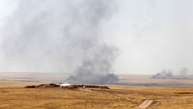 A view is seen of smoke billowing after American air strikes in Khazir