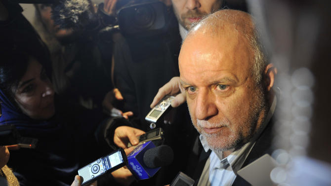 Iran's Minister of Petroleum Bijan Namdar Zangeneh talks ro journalists as he arrives at a hotel in Vienna, Austria, on Tuesday, Dec. 3, 2013. The Organization of Petroleum Exporting Countries, OPEC, will meet on Wednesday to decide on the cartel's oil output against a backdrop of slowing crude demand and unrest in member nation Libya. (AP Photo/Hans Punz)