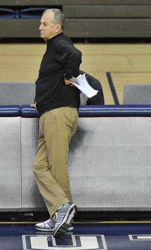 FILE - In this March 2, 2012, file photo, Connecticut men's basketball coach Jim Calhoun watches players during practice after his return from back surgery, in Storrs, Conn. Calhoun fractured a hip in a bicycle accident Saturday, Aug. 4, 2012, hours before he was supposed to coach a group of his former players in a charity game. (AP Photo/Jessica Hill, File)