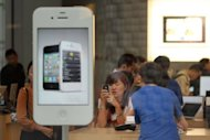 "<p>Customers looking at products in an Apple store in Beijing. A labour rights group said June 28, it had found ""deplorable"" conditions at Apple suppliers in China, following a probe of several firms that supply the US technology giant.</p>"