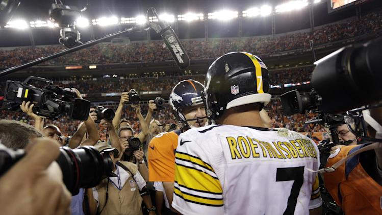 Denver Broncos quarterback Peyton Manning (18) shakes hands with Pittsburgh Steelers quarterback Ben Roethlisberger after the Broncos defeatd the Steelers 31-19 during an NFL football game, Sunday, Sept. 9, 2012, in Denver. (AP Photo/Joe Mahoney)