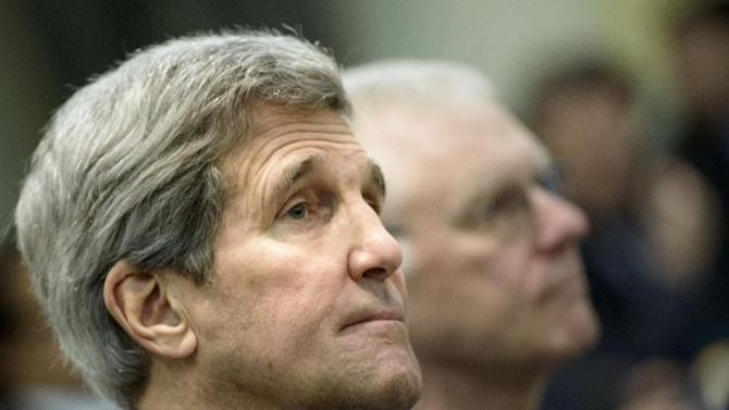 U.S. Secretary of State John Kerry waits for the start of a meeting on Iran's nuclear program with officials from Britain, France, Germany, China, the European Union and Iran at the Beau Rivage Palace Hotel in Lausanne, Switzerland Tuesday, March 31, 2015. Diplomats scrambled Tuesday to reach consensus on the outline of an Iran nuclear deal just hours ahead of a self-imposed deadline to produce an agreement. (AP Photo/Brendan Smialowski, Pool)