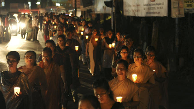 In this Wednesday, Dec. 12, 2012 photograph, people participate in a candle light rally in Mangalore, India to pay their respects to nurse Jacintha Saldanha, who killed herself in London after taking a hoax call from Australian DJs about the pregnant Duchess of Cambridge. (AP Photo)