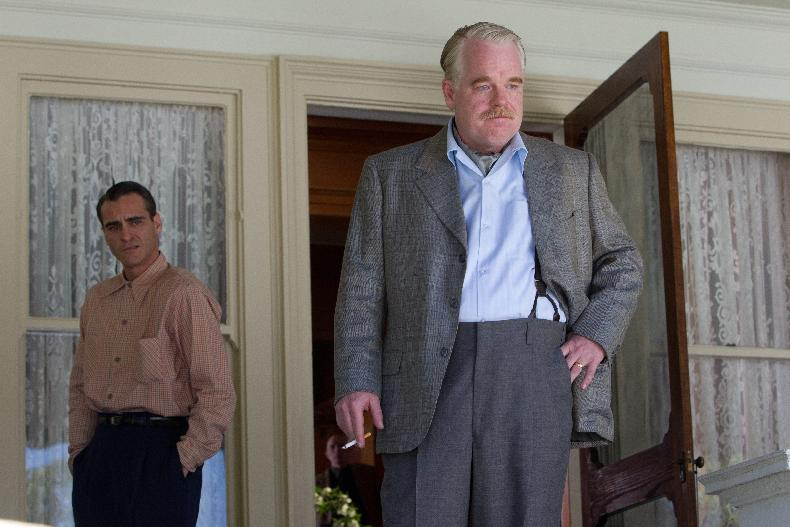 "This film image released by The Weinstein Company shows Joaquin Phoenix, left, and Philip Seymour Hoffman in a scene from ""The Master.""  The film will be presented at the 37th Toronto International Film festival running through Sept. 16. (AP Photo/The Weinstein Company)"