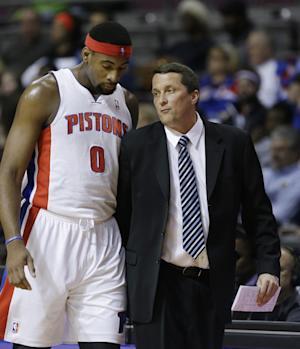 Detroit Pistons center Andre Drummond (0) talks with interim head coach John Loyer during the first half of an NBA basketball game against the San Antonio Spurs in Auburn Hills, Mich., Monday, Feb. 10, 2014. (AP Photo/Carlos Osorio)