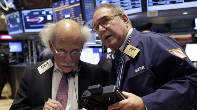 FILE - In this Tuesday, Nov. 19, 2013, file photo, traders Peter Tuchman, left, and Eugene Mauro confer on the floor of the New York Stock Exchange. The Dow's first close above 16,000 pushed most world stocks higher Friday Nov. 22, 2013 but gains were kept in check by worries the Federal Reserve will cut its monetary stimulus soon. (AP Photo/Richard Drew, File)