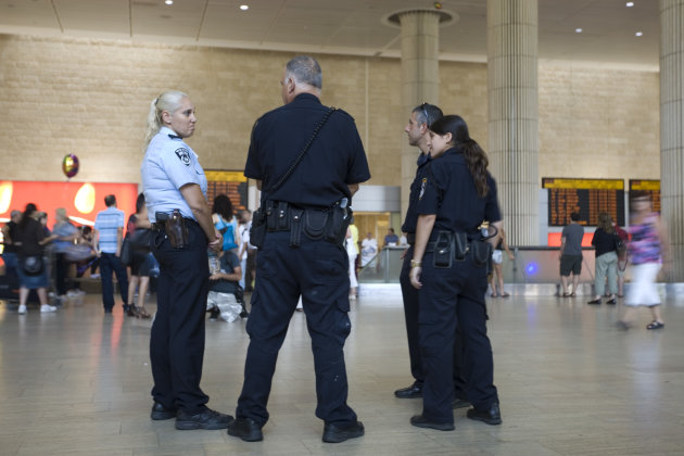 Israeli police officers stand guard at Ben Gurion international airport near Tel Aviv , Israel,Thursday, July 7, 2011. Hundreds of pro-Palestinian foreign activists planned to fly into Tel Aviv this week, prompting Israeli warnings that security would be beefed up at the country&#39;s already heavily fortified international airport.The campaign coincides with a separate attempt to break Israel&#39;s sea blockade of the Gaza Strip with an international flotilla. (AP Photo/Ariel Schalit)
