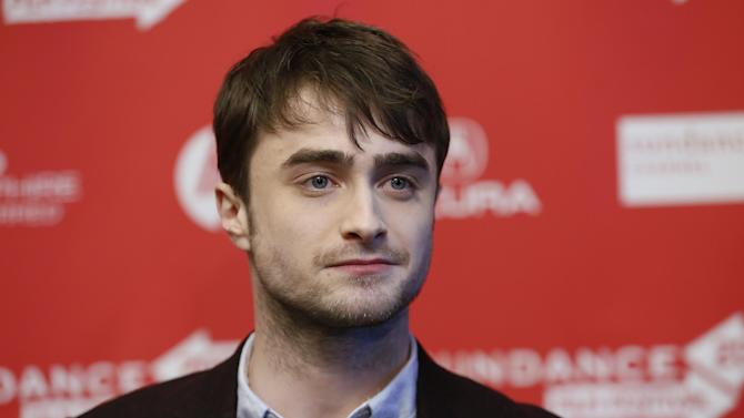"""Actor Daniel Radcliffe poses at the premiere of """"Kill Your Darlings"""" during the 2013 Sundance Film Festival on Friday, Jan. 18, 2013 in Park City, Utah. (Photo by Danny Moloshok/Invision/AP)"""