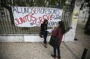 Students wait near a banner for the arrival of their teachers to conduct their university entrance exams in Lisbon
