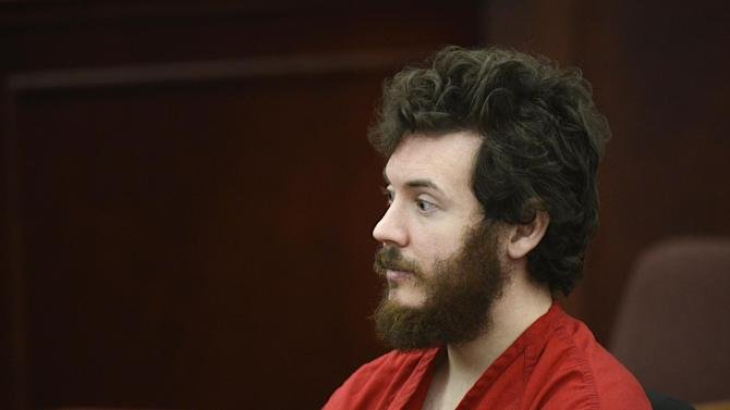 FILE - James Holmes, Aurora theater shooting suspect, sits in the courtroom during his arraignment in Centennial, Colo., in a Tuesday, March 12, 2013 file photo. Holmes' lawyers plans to ask a judge on Monday, May 13, 2013 to enter a plea of not guilty by reason of insanity, a move that is widely seen as Holmes' best hope of avoiding the death penalty. (AP Photo/Denver Post, RJ Sangosti, Pool, File)