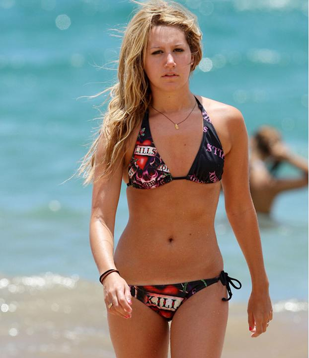 Celebrities in bikinis: Ashley Tisdale rocked a bikini with an Ed Hardy print and looked amazing doing so.