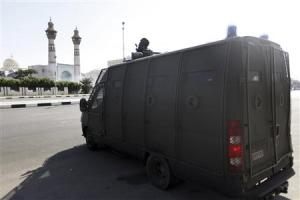A riot police vehicle is parked in front of Al-Azhar University during clashes with protesters in Cairo
