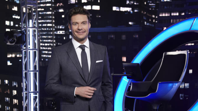 """This Aug. 8, 2013 photo released by NBC shows host Ryan Seacrest on the set of his show, """"Million Second Quiz,"""" in Los Angeles. The show debuted last Monday, Sept. 9, 2013, to an audience of just over 6.5 million viewers, and proceeded to get a smaller crowd watching it each succeeding night last week, the Nielsen company said. (AP Photo/NBC, Rodolfo Martinez)"""