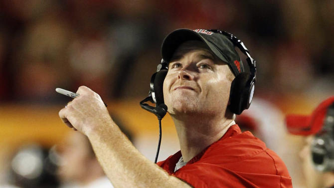 Northern Illinois head coach Rod Carey reacts at the end of the first half of Orange Bowl NCAA college football game against Florida State, Tuesday, Jan. 1, 2013, in Miami. (AP Photo/Alan Diaz)
