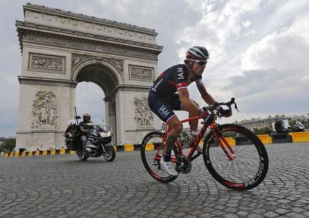 Iam team rider Chavanel of France rides near the Arc de Triomphe at the end of the final 21st stage of the Tour de France in Paris