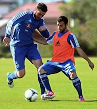 Greece's national football team Vasilis Torosidis (L) and Giannis Fetfatzidis attend a training session in Kitzbuhel on May 25, 2012, as part of the team preparation for the the Euro 2012 championships.    AFP PHOTO-/AFP/GettyImages