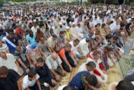 Muslims pray around the mosque in Toulouse, southern France, on July 20. Tensions between French authorities and the country's Islamic community resurfaced on Tuesday after it emerged that four summer camp instructors had been sacked for fasting during Ramadan