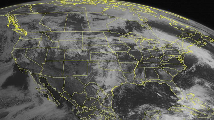 This NOAA satellite image taken Wednesday, May 29, 2013 at 10:45 AM EDT shows a low pressure system over the central United States with widespread showers and thunderstorms from Texas into the Northern Plains. Farther east, a warm front extended into the Northeast with showers and thunderstorms. Tropical Storm Barbara can be seen south of Mexico. (AP PHOTO/WEATHER UNDERGROUND)