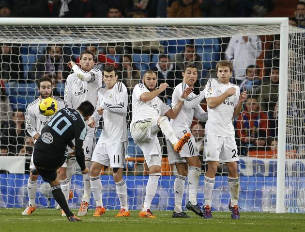 Celta Vigo's Nolito tries to score past Real Madrid players Carbajal, Ramos, Bale, Benzema, Ronaldo and Illarramendi during their Spanish First Division soccer match at Santiago Bernabeu stadium i