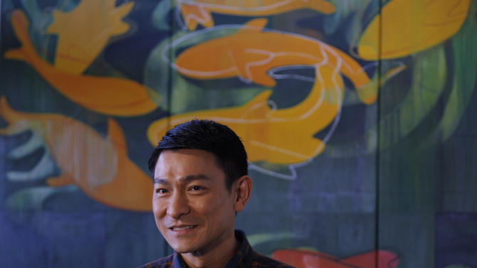 """Hong Kong actor Andy Lau reacts as he speaks to reporters during a film shoot with his new movie """"To Tse"""" in Hong Kong Monday, Feb. 28, 2011. Hong Kong has produced Chinese cinema's biggest names, but for the former British colony's actors and directors, the future now lies in the thriving mainland market. One of the territory's biggest stars, Lau, is no exception. (AP Photo/Vincent Yu)"""