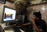 A man looks at YouTube at an internet cafe in Karachi. Pakistan briefly unblocked access to the popular video sharing website on Saturday before Prime Minister Raja Pervez Ashraf ordered the plug be pulled again