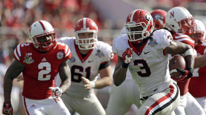Georgia running back Todd Gurley (3) runs for a 24-yard touchdown past the Nebraska defense during the first half of the Capital One Bowl NCAA football game, Tuesday, Jan. 1, 2013, in Orlando, Fla. (AP Photo/John Raoux)