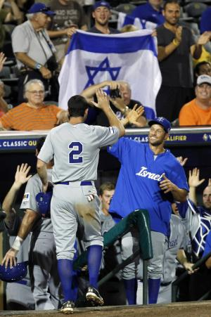 Israel's Josh Satin (2) is congratulated after scoring on a double by Charlie Cutler against South Africa in the eighth inning of a World Baseball Classic qualifier baseball game in Jupiter, Fla., Wednesday, Sept. 19, 2012. Shawn green and Jack Marder also scored on the double. Israel won 7-3. (AP Photo/Alan Diaz)